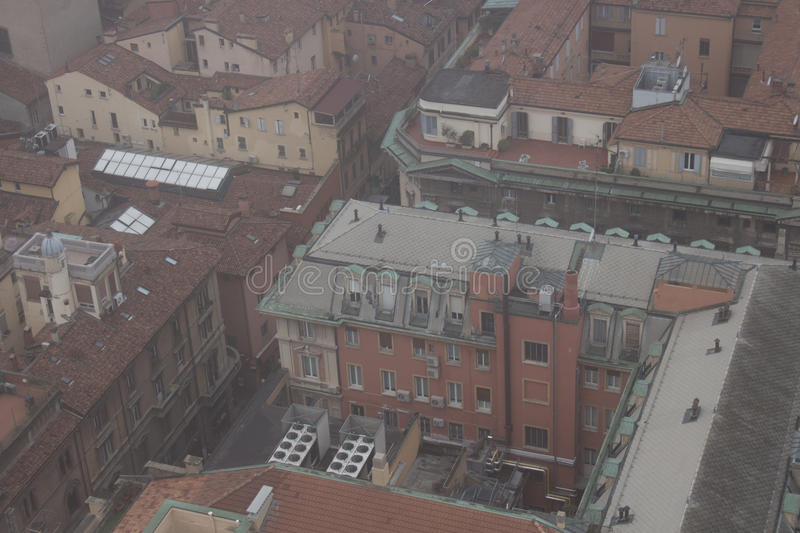 Typical buildings of Bologna in a foggy day. View from a narrow window of Asinelli Tower. Emilia Romagna , Italy. stock images