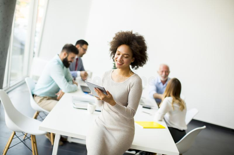 Multiethnic business team working at the same office stock photography