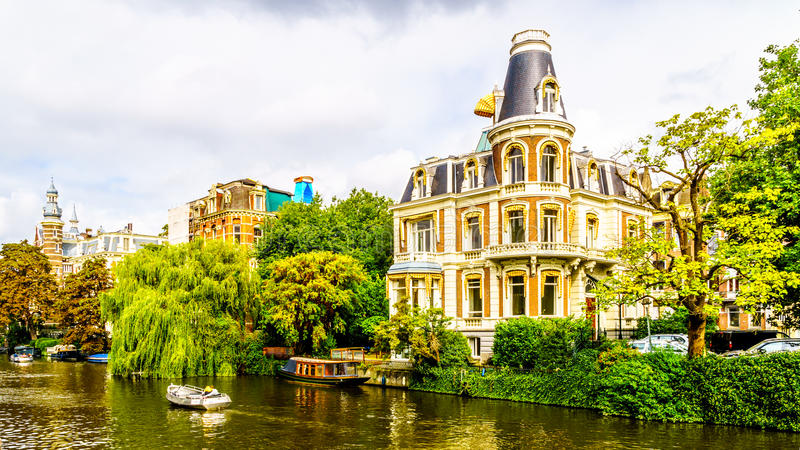 Typical Canal Scene with Historic Houses in Amsterdam stock photography