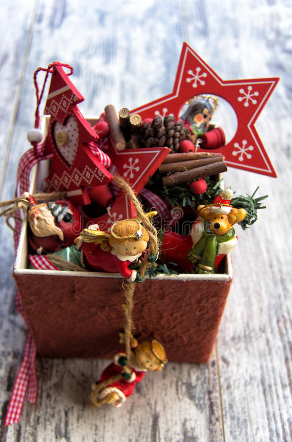Typical Christmas decorations in a box on wooden background. Christmas decorations in a box on wooden background stock image