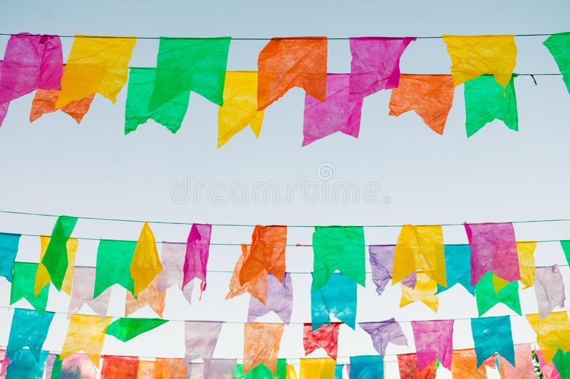 Typical colorful flags used for decoration at the June Festivals aka festas de Sao Joao, with copy space. Oeiras, Piaui - Brazil royalty free stock image