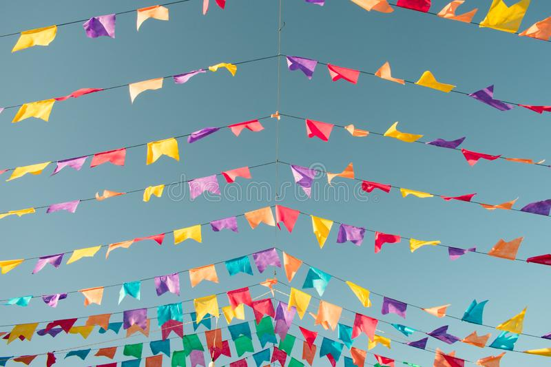 Colorful flags used for decoration at the June Festivals aka festas de Sao Joao, popular festivities in Brazil. Typical colorful flags used for decoration at the stock photo