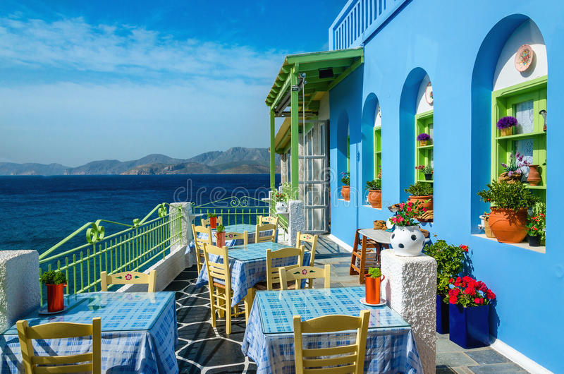 Typical colorful Greek restaurant, Kalymnos, Dodecanese Islands, Greece royalty free stock photos