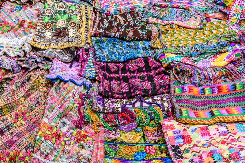 Colorful handwoven textiles in Guatemalan market. Typical colorful handwoven Guatemalan textiles made & sold by local indigenous women at markets in Guatemala stock photography