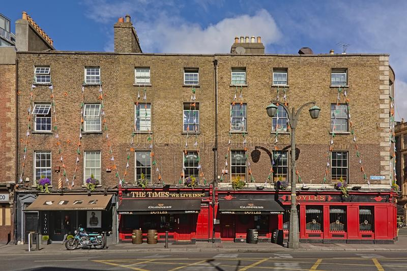 Typical Irish pubs in Dublin, Ireland. Typical colorful  Irish pubs with apartments above in  Dublin, Ireland royalty free stock image