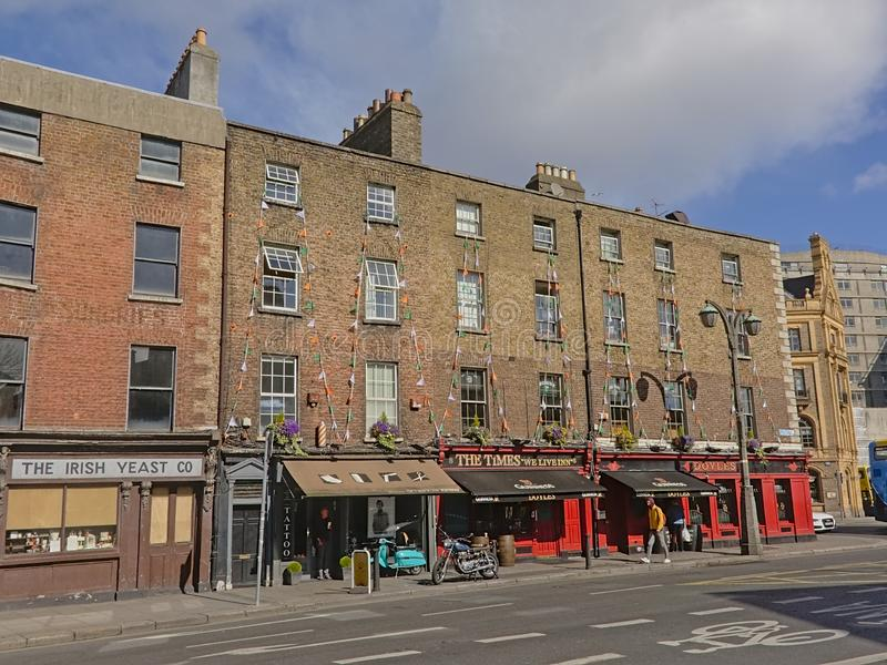 Typical Irish pubs in Dublin, Ireland. Typical colorful  Irish pubs with apartments above in  Dublin, Ireland stock photos