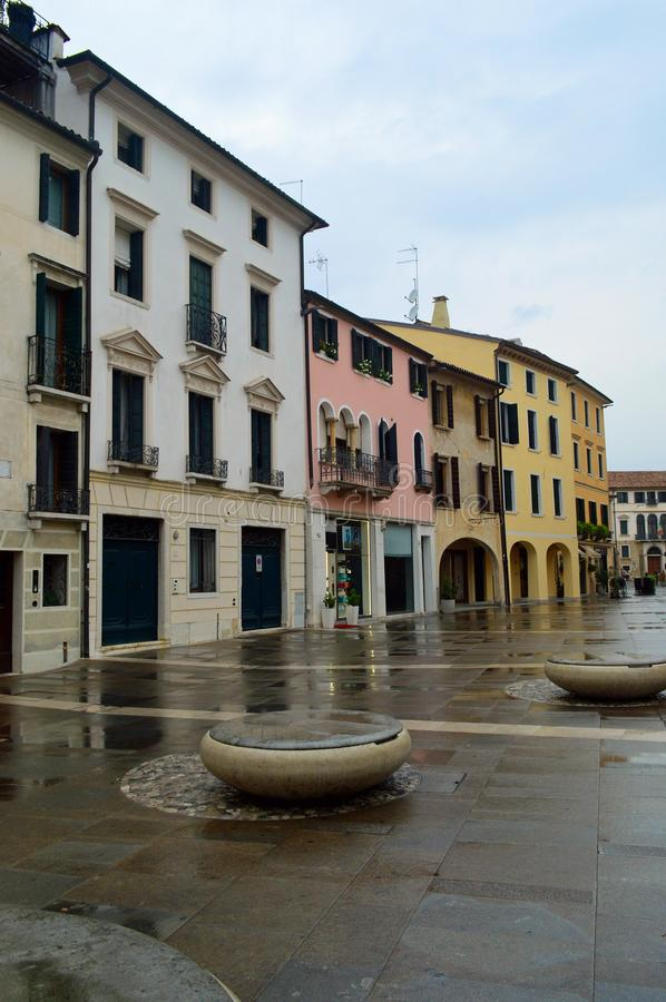Typical colour treviso architecture on a cloudy day. Typical colourful italianate venetian style architecture on a cloudy day lining a small piazza Treviso royalty free stock photos