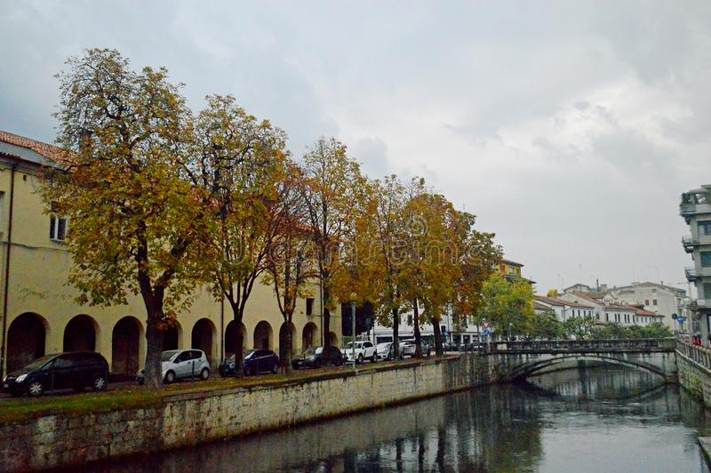 Typical treviso architecture by the river on a cloudy day. Typical colourful italianate venetian style architecture on a cloudy day lining the River Sile Treviso royalty free stock image