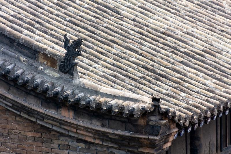 Typical decorated roofs of the houses of Pingyao Ancient city, Shanxi province, China. Known as one of the best preserved villages of China, Pingyao is a royalty free stock photo