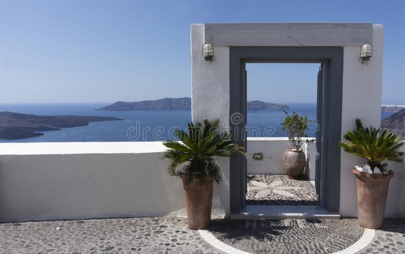 Typical design decoration door of Santorini Greece with way into the sea with copy space. Typical design decoration door of Santorini Greece in Fira with way royalty free stock photo
