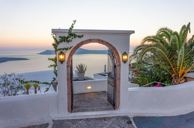 Typical design decoration door of Santorini Greece with way into the sea with suset. Sunrise stock image