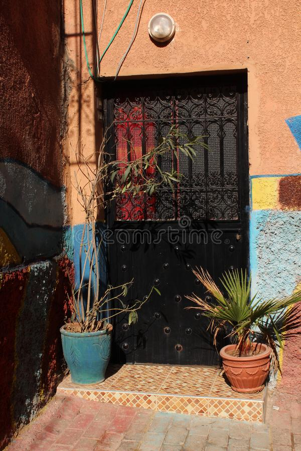 Typical door of a city house in medina - historical centre of Marrakesh stock photo