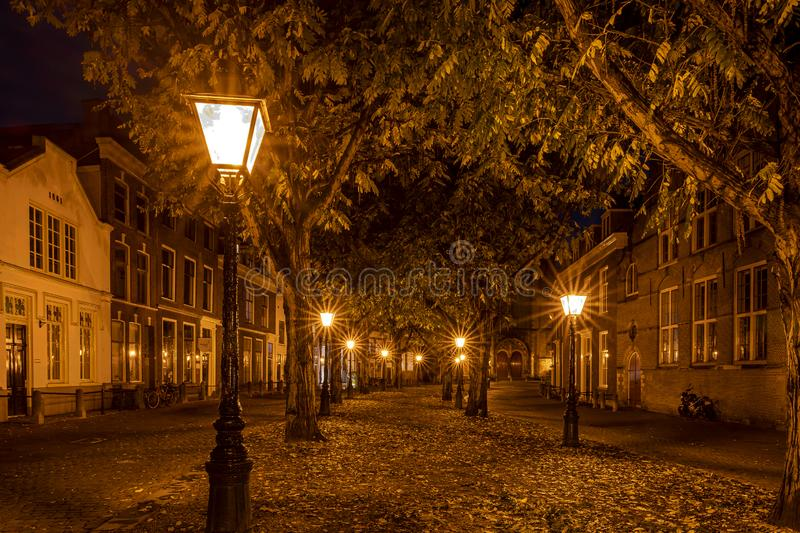 A typical Dutch street The Hooglandse Kerkgracht, with old buildings and beautiful, lighted lamp posts, Leiden, the Netherlands stock photos