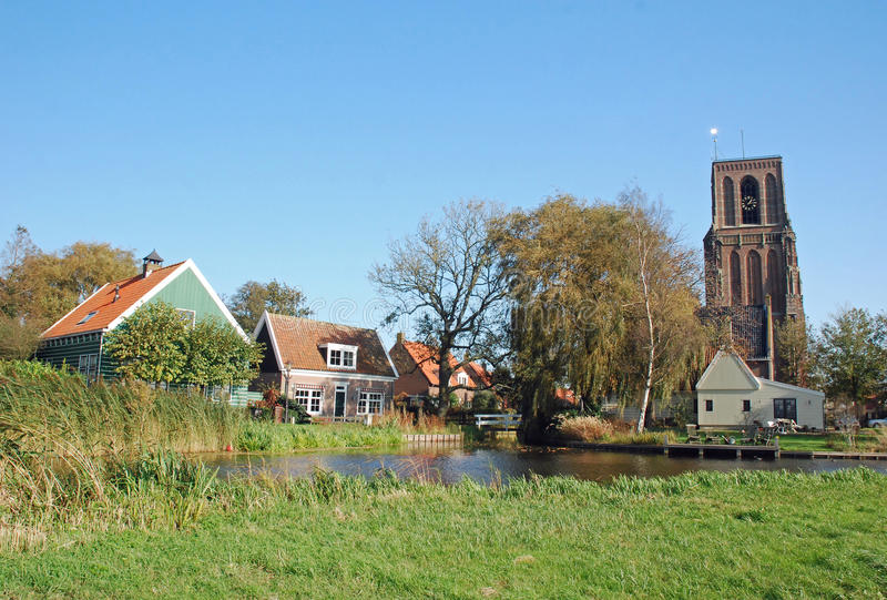 Amsterdam North - Typical Dutch village-church tower. Amsterdam North - Nationally protected rural Ransdorp blunt late-Gothic church tower and colorful old Dutch royalty free stock image