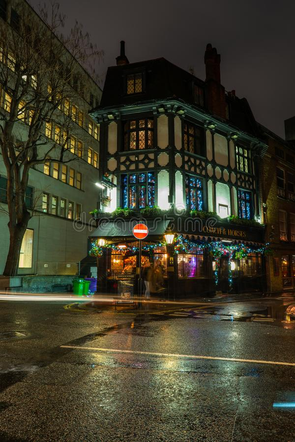 Typical English pub in Burton street, Mayfair is decorated for Christmas royalty free stock photography