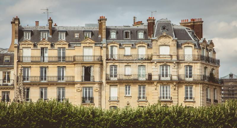 Typical facade of Parisian apartment building in bad weather stock image