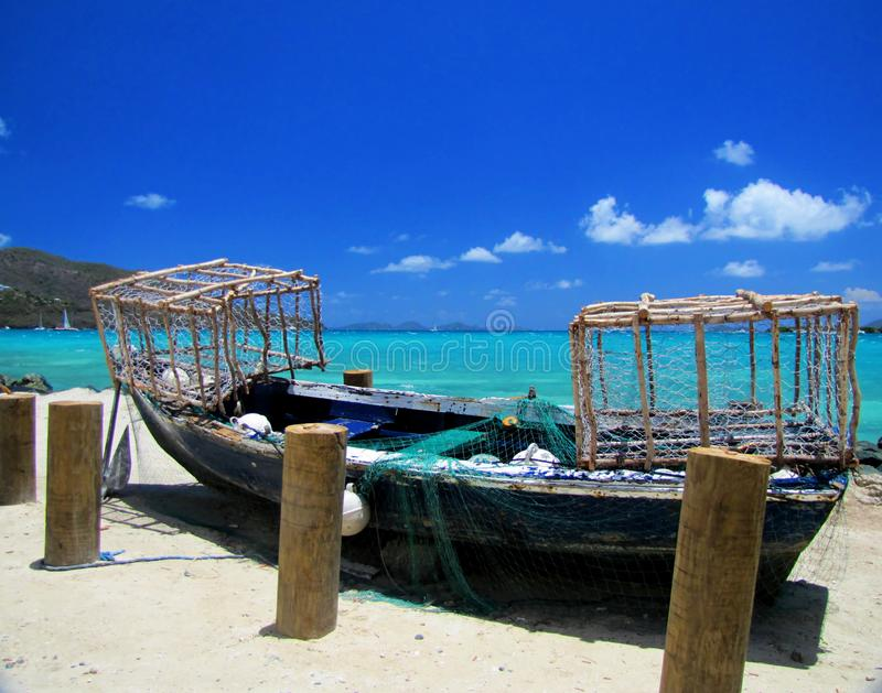 Typical fishing boat in display on a beach. With lobster cages royalty free stock photography