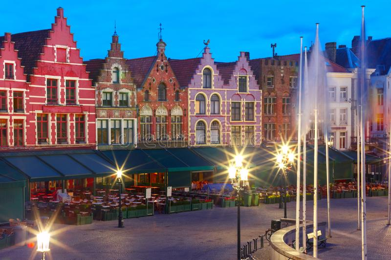 Old Market square in Bruges, Belgium. Typical Flemish colored houses on the Grote Markt or Market Square in the center of Bruges during morning blue hour royalty free stock photo