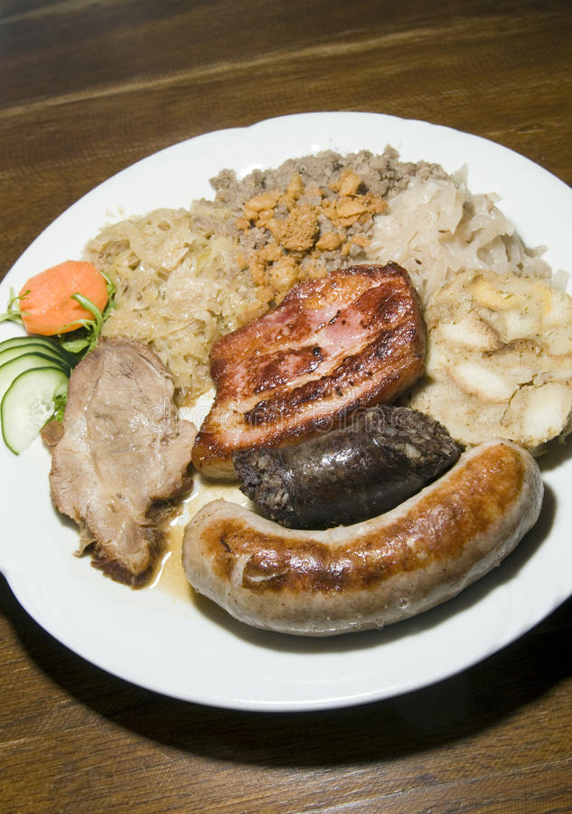 Typical food Slovenia black pudding fried sausage dried pork cho