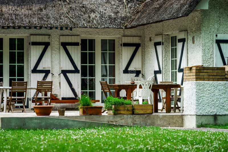 Typical french countryside house with thatch roof stock photos