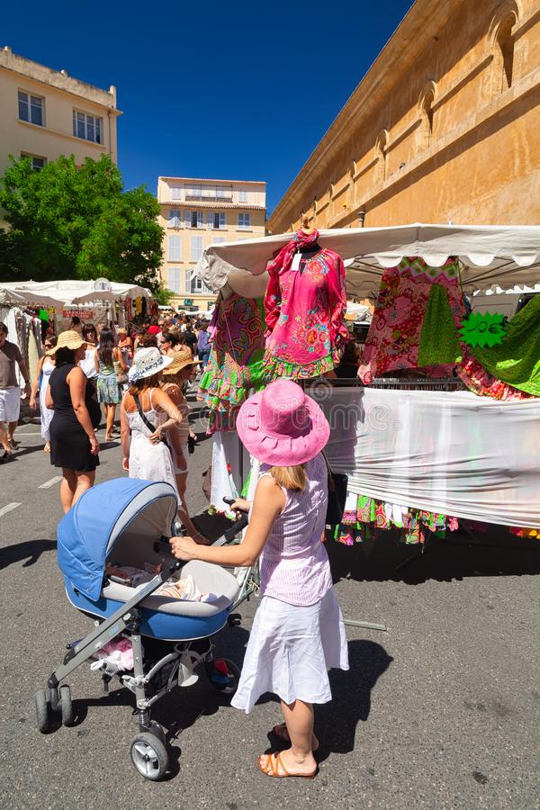 A typical French market in the Provence in summer with a woman s. Hopping during her vacation - Summer Travel image stock photography