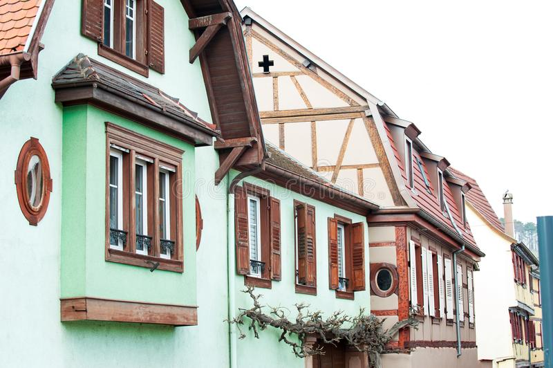 Typical French provencal style multicolored houses with wooden s. Hutters and decorative iron blacksmith balcony in France, Alsace region. Vibrant outdoors stock photos