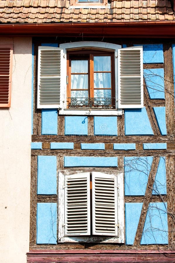 French provencal style blue house with windows. Alsace, France. Typical French provencal style vibrant blue colored house with windows and white wooden shutters royalty free stock photography