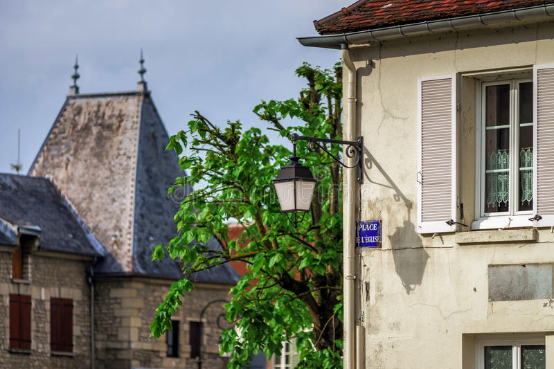 Typical french village street with retro-style lanterns stock photography