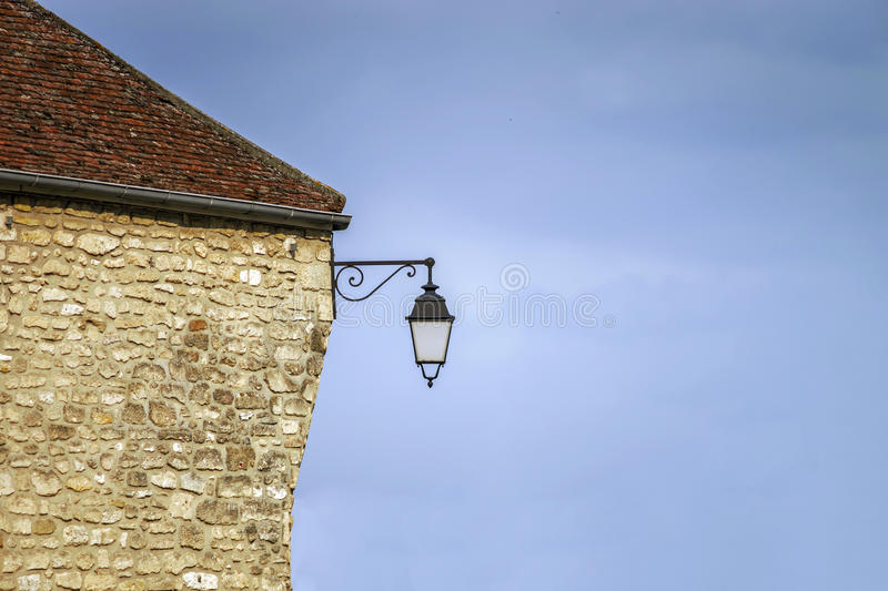 Typical french village street with retro-style lanterns royalty free stock image