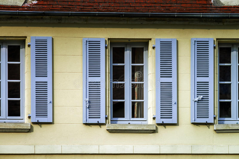 Typical french windows with wooden shutters stock images