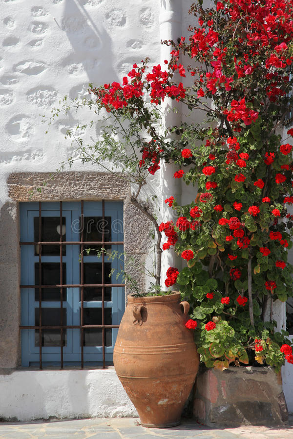 Typical greek house. Facade of a typical greek house with plants royalty free stock photography
