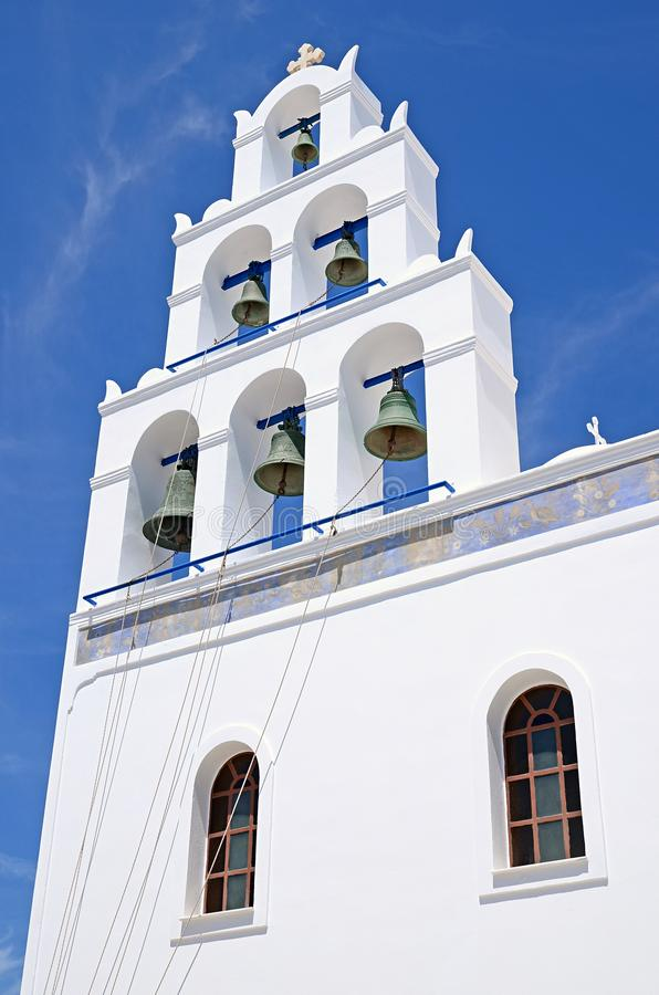 A typical Greek Orthodox church bell tower with multiple bells, Santorini, Greece stock photography