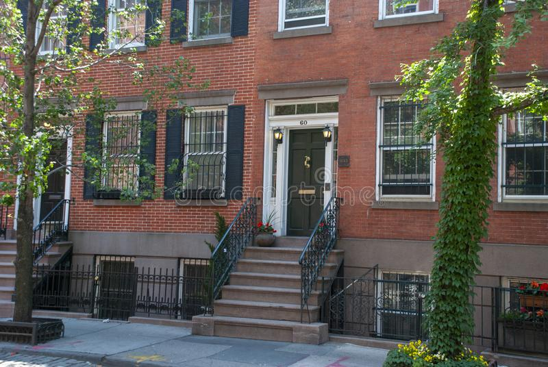 Typical Greenwich Village brick stone houses with iron railings and stairs stock images