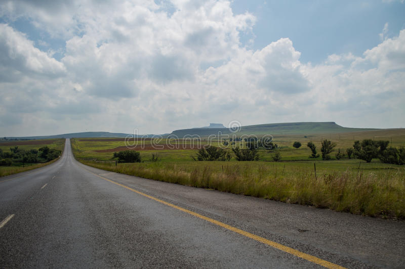 Typical Hily Landscape with Highway close to Golden Gate. Highlands National Park in South Africa's Freestate stock photo