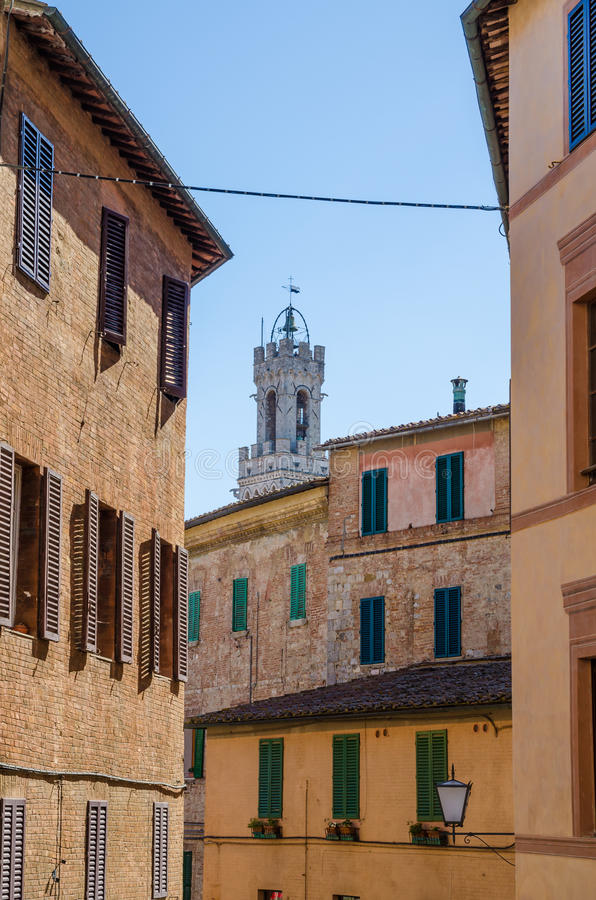 Download Typical Historic Italian Town Houses With Many Windows, Soft Colors And Palazzo Pubblico Tower, Siena, Italy Stock Image - Image: 83703581