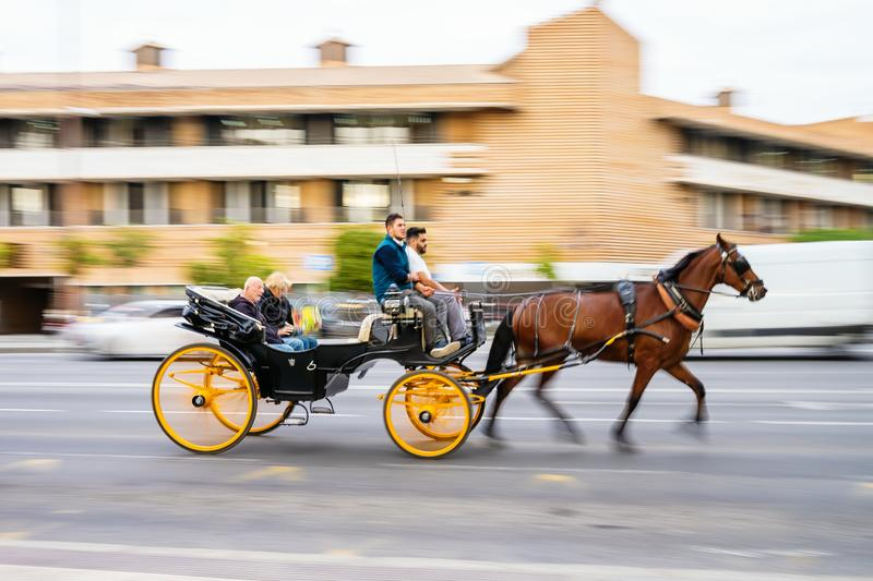 Typical horse carriage for tourist transport in motion blur in Seville, Spain stock photography