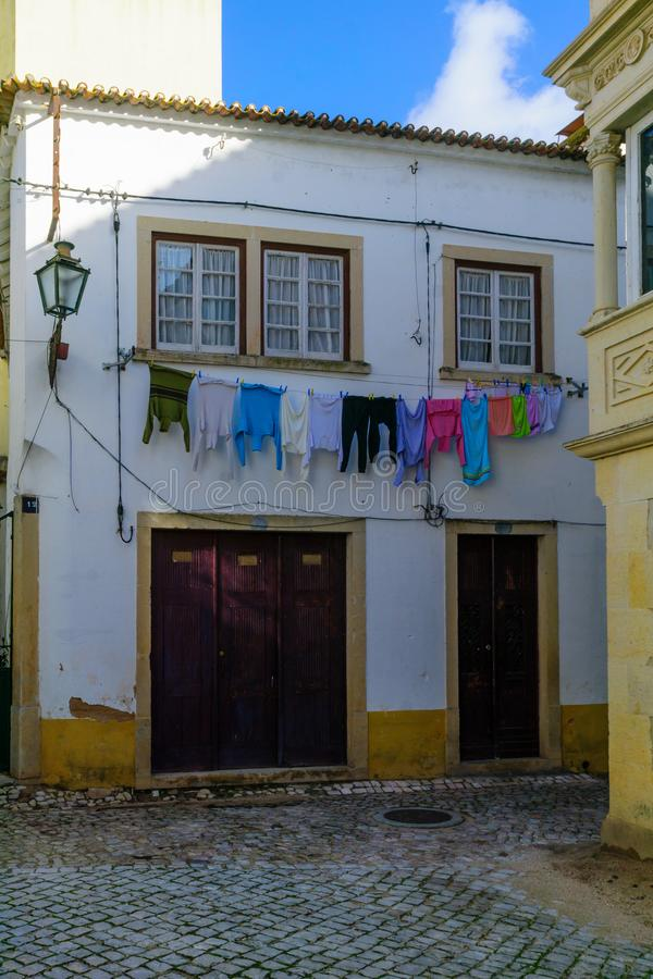 Typical house, with hanged laundry, in the old town of Tomar stock photos