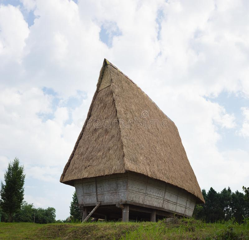 Typical house of J`rai people in central high land of Vietnam, Rong house in Vietnamese.  royalty free stock image