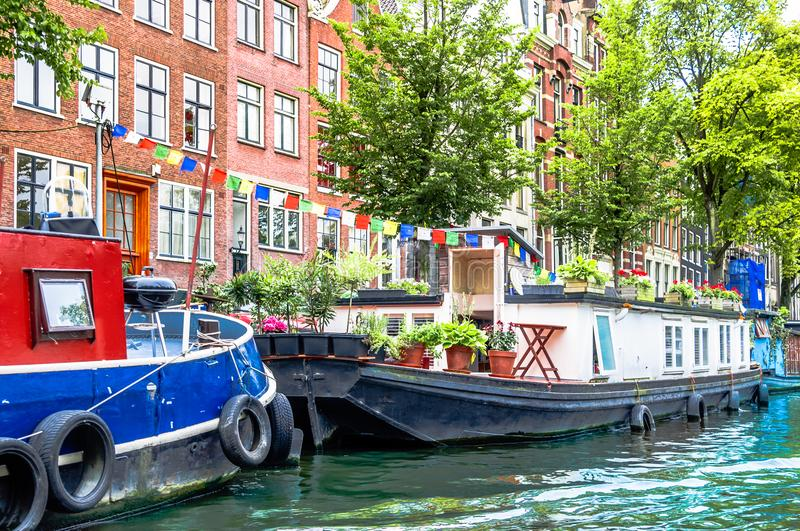 Typical houseboat at the canal of Amsterdam. View on Typical houseboat at the canal of Amsterdam stock photography