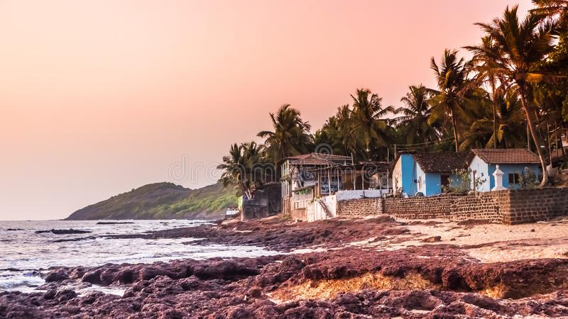 Typical houses at famous Anjuna beach by sunset, Goa, India royalty free stock photography
