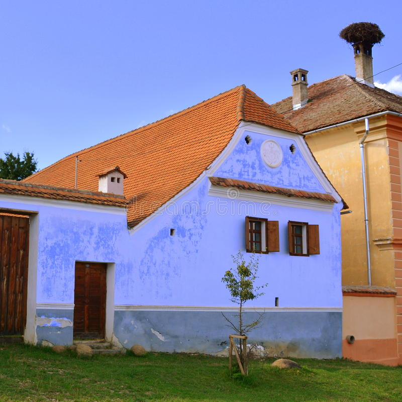 Typical houses in the village Viscri, Transylvania. Viscri is known for his fortified church. The fortified church in this village was built around 1100 AD. It royalty free stock image