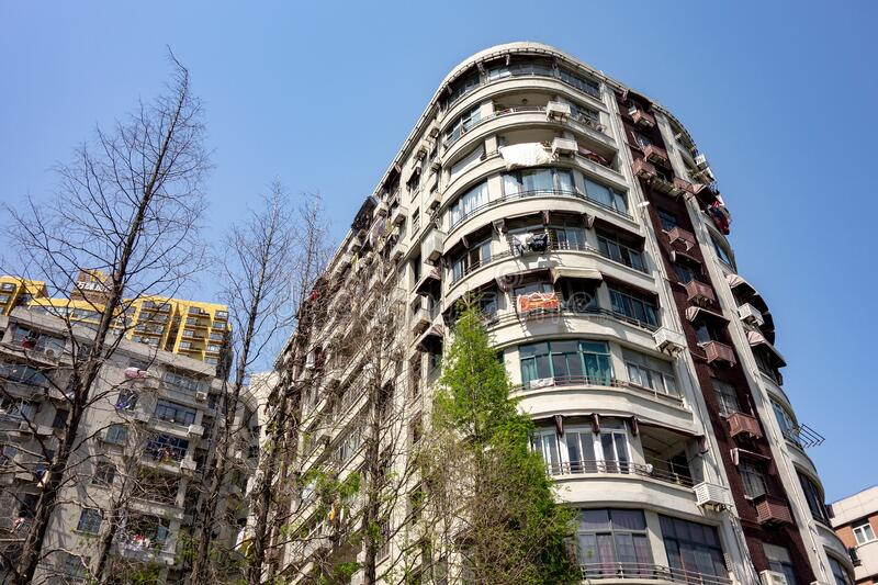 Typical housing in Shanghai, China with rounded balconies and blue sky royalty free stock photography