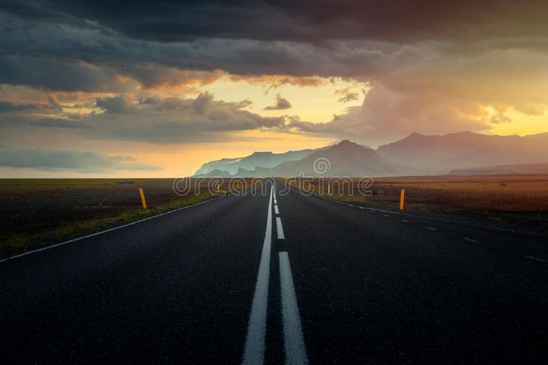 Typical icelandic landscape with empty road and scenic nature royalty free stock image