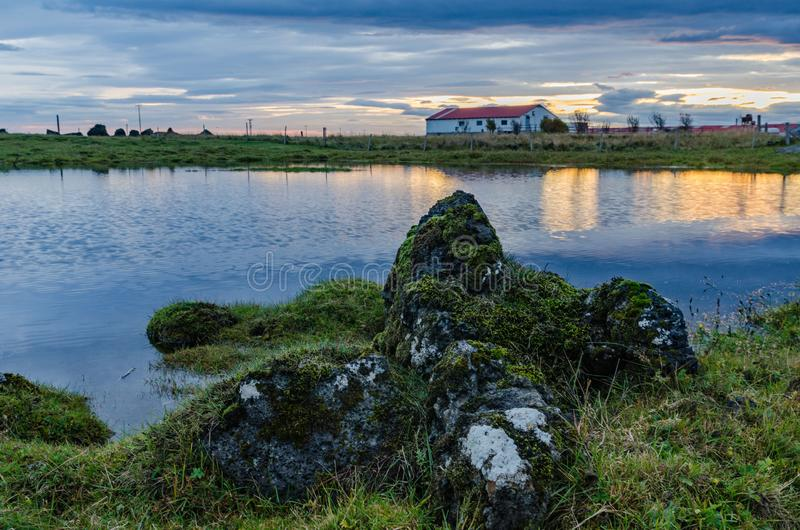 Iceland, autumn, sunrise, old farm, Typical icelandic landscape. Typical icelandic landscape Iceland autumn old farm royalty free stock image
