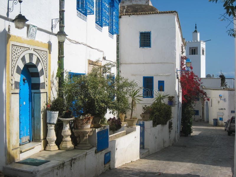 Picturesque street in the medina. Sidi Bou Said. Tunisia. Typical islamic archways and white houses and blue windows. The town was named after sidi Abou Said ibn royalty free stock images