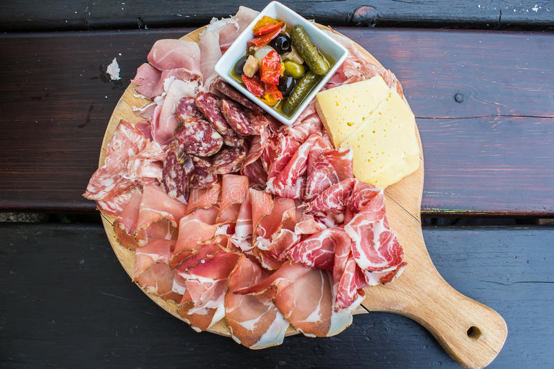 Typical Italian appetizer with salami, cheese and pickles stock image