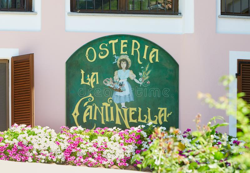 Typical Italian restaurant sign with flowers in a sunny day royalty free stock photo
