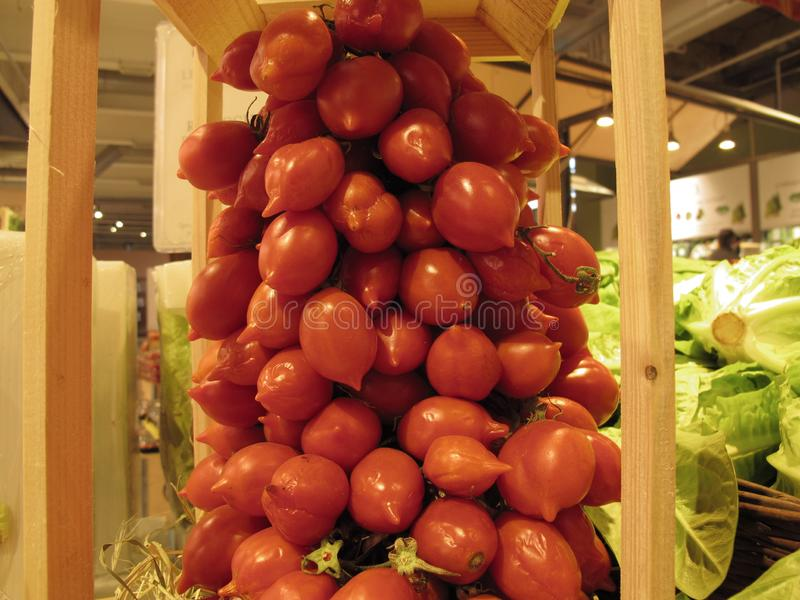 Typical italian vegetables the tomatoes. Typical italian vegetables the little tomatoes stock photography