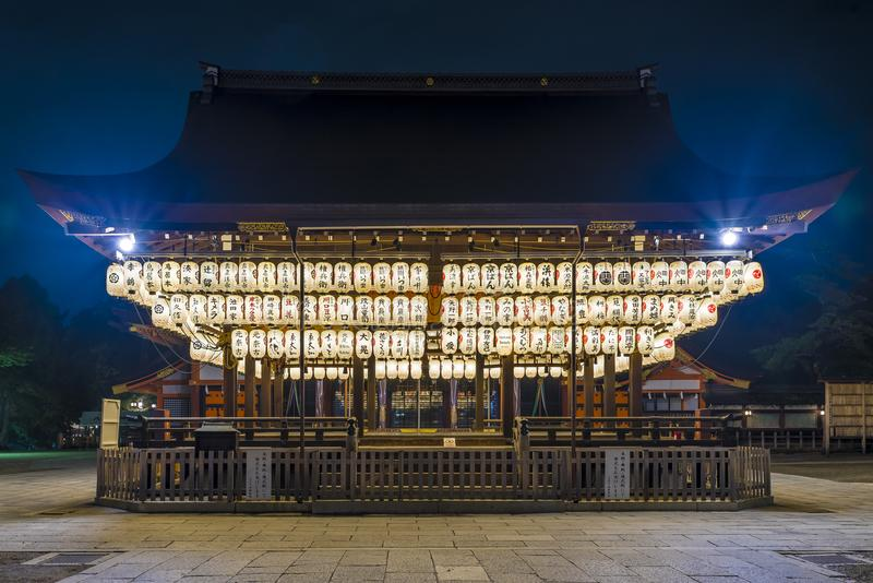 Typical Japanese Temple and Shrine, with brightly lit lanterns all around the main structure stock photography