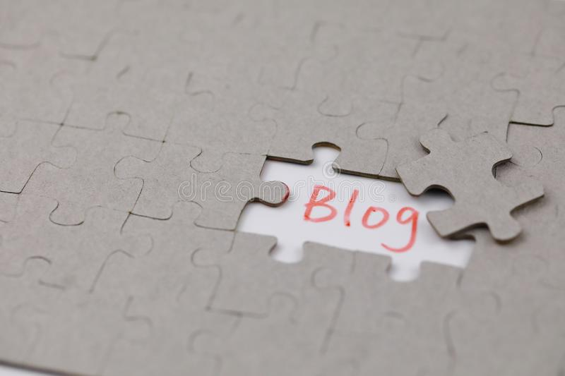 A typical jigsaw puzzle with blog. A typical jigsaw puzzle with a gap and blog. The last piece of jigsaw puzzle concept for solution and completion stock image